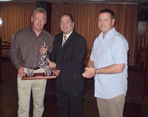 Nick Smith receives his decanter set from Nat Coles and Pete Mills
