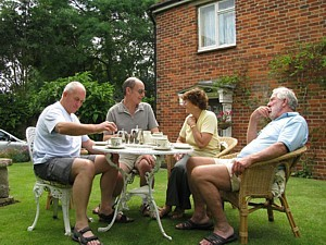 Holloway, Hoole, Jill and Barlow enjoy tea on the lawn