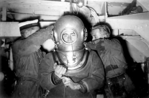 Roy Rees (right) helping to dress the late MCDOA member George Wookey for his 600 ft World Record Dive