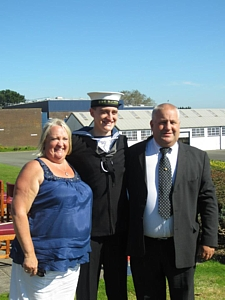 Wendy & Jim Carlin flanking their son James after his initial training