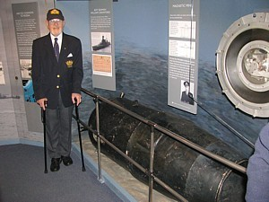 Wartime Bomb & Mine Disposal Officer and author Lt Noel Cashford MBE RNVR with Ouvry's mine on board HMS Belfast