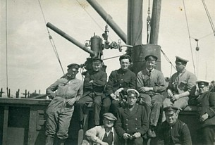 RN salvage team in 1919 with Rodney's grandfather wearing a white cap cover