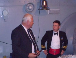 Peter Harrison, Vice Chairman of the TCA, presents a TCA badge to HMS Cattistock's CO