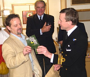 Tony Groom receives fragment of unexploded bomb he helped remove from HMS Argonaut