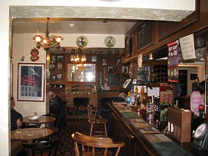 The long bar of The Woodmancote Arms