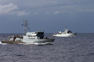 FGS Homberg and HMS Roebuck manoeuvre close to HMS Ledbury in a recent navigation exercise