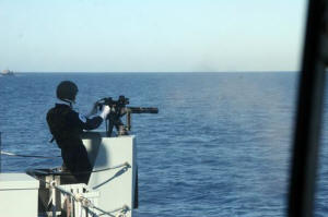 AB(MW) Kieron Putt fires Ledbury's port Mk 44 MiniGun during a gunnery serial off Corsica