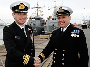 Cdr Serge Ots BN handing over to Cdr Chris Davies RN